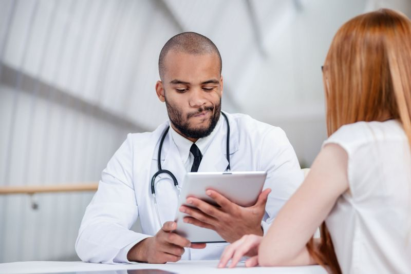 doubtful doctor looking at results