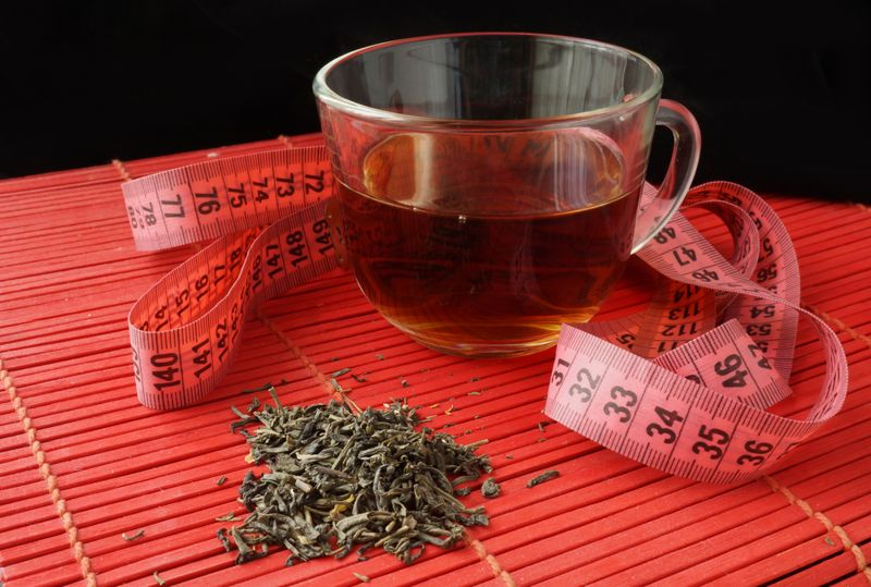 tea for weight loss concept with measuring tape