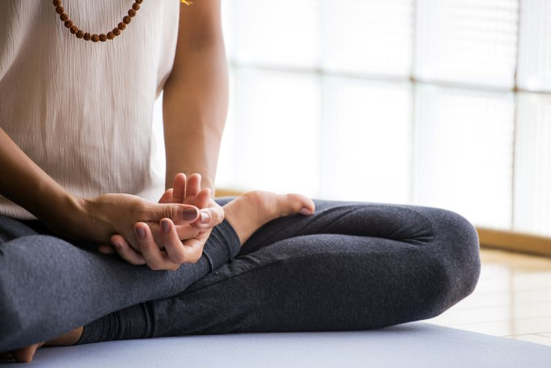 woman with hands in lap meditating