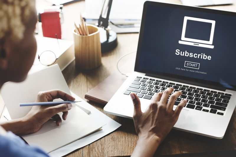 woman on laptop subscribing to a newsletter