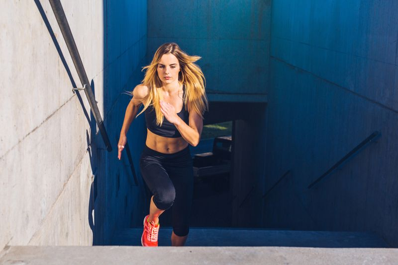 woman running up stairs outside