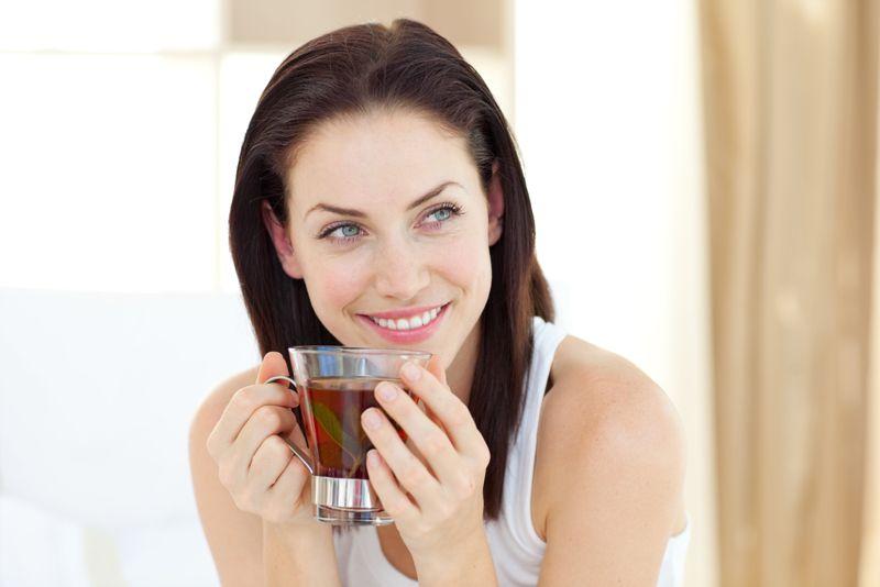 happy looking woman drinking tea