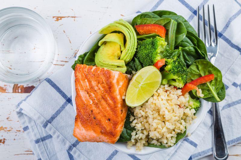 healthy salmon and grains salad bowl