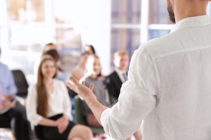 presenter in white shirt giving a speech