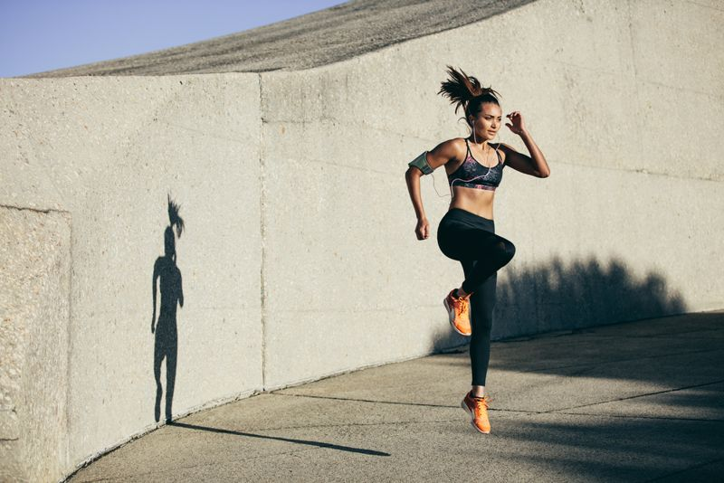 woman doing explosive jump workout outside