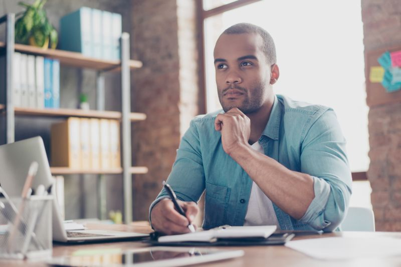 man trying to make a decision working remotely