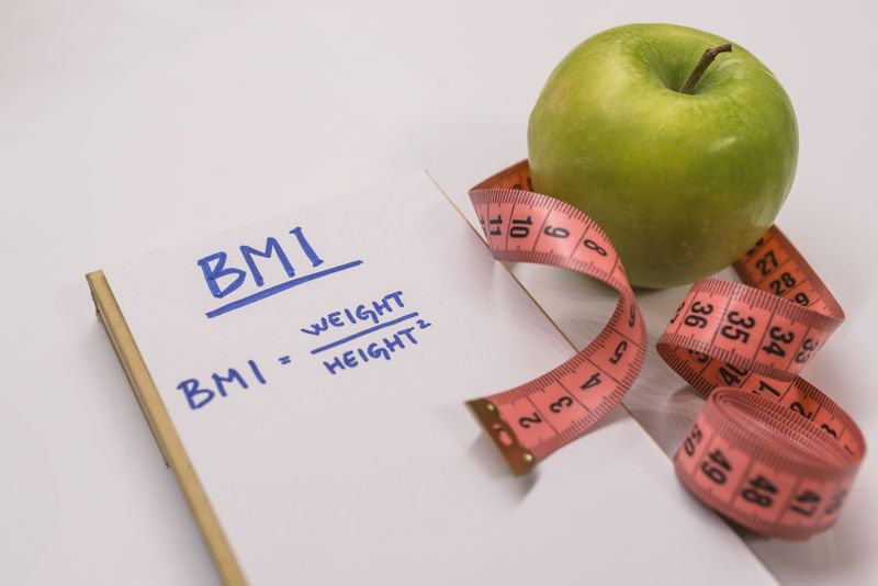 BMI concept with measuring tape and apple