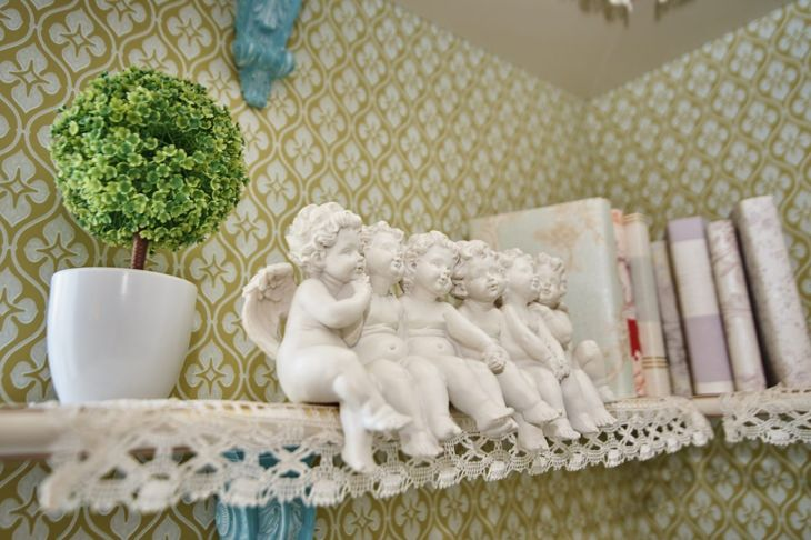angel figurines shelf