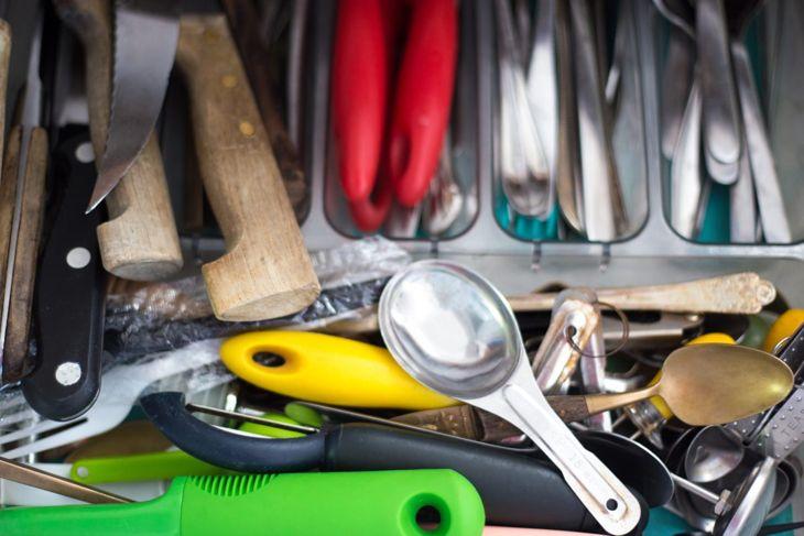 messy kitchen utensil drawer