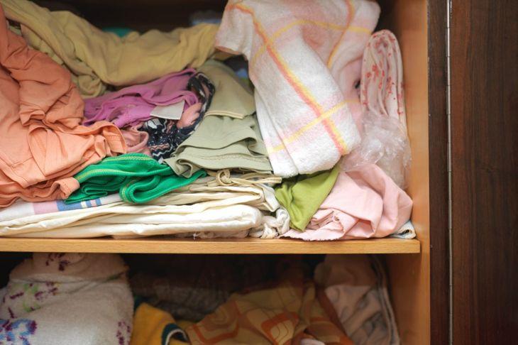 messy linen closet towels