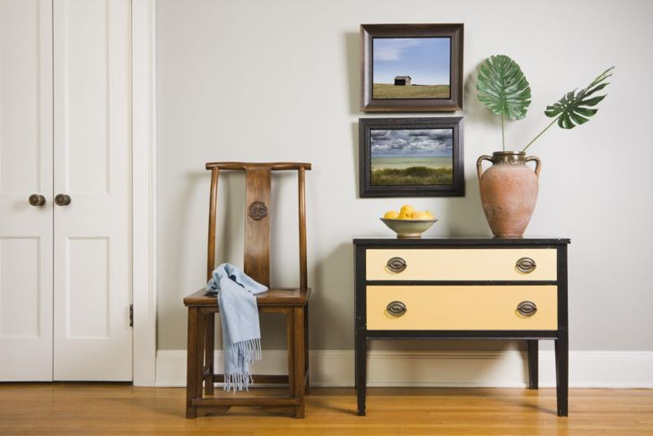 Basic framed photos paired with simple furniture pieces create a charming effect.