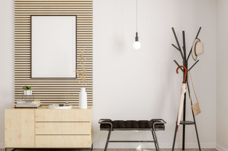 Modern hallway interior with frame, hanging umbrella and shoe cabinet