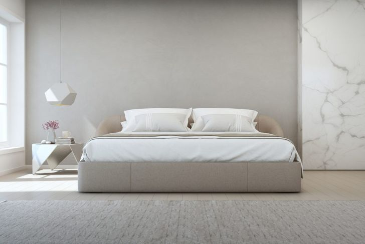 With strategic wallpaper application, you can create a high-end look for any bedroom.