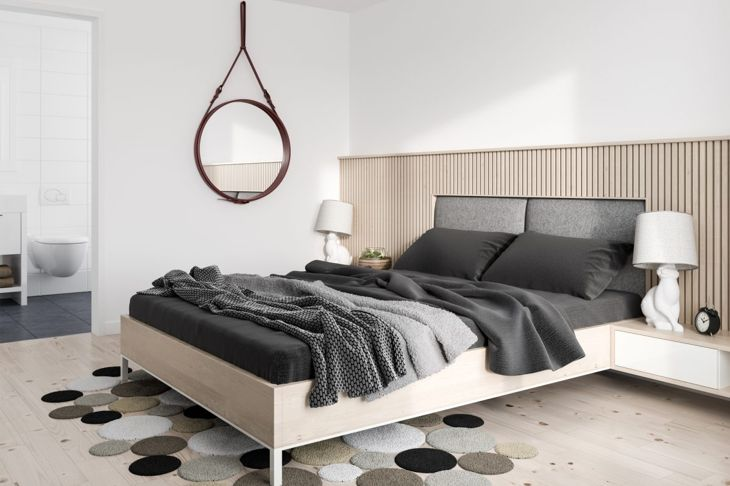 This creative floor covering gives the minimalist decor of this bedroom a bit of flair and individuality.