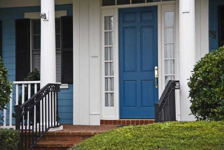 A Classic Blue front door evokes a confident and serene household.