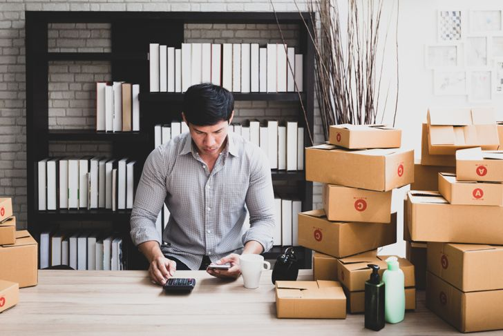 Men working at home selling online in small business