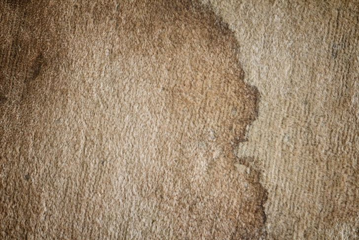 A close-up of a dried carpet stain