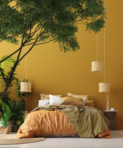 Bedroom with yellow walls and greenery