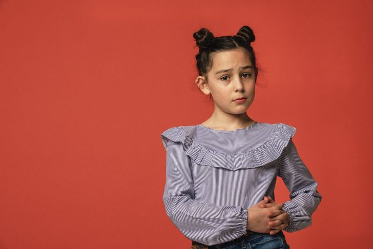 Young girl with space buns