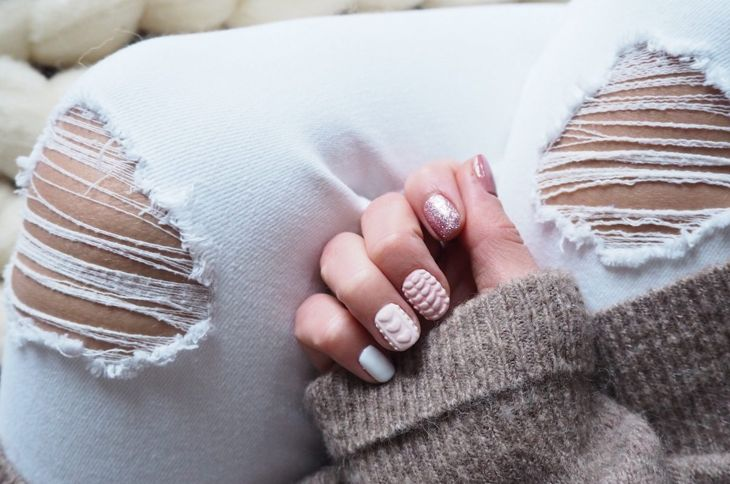 A nude-colored manicure featuring textured 3-D nails