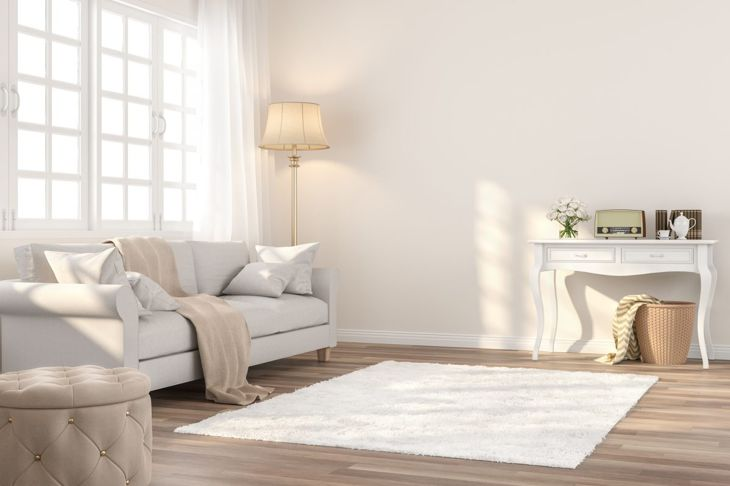 Cream living room with wooden flaws