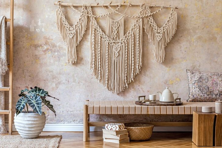 A large rustic tiered and draped macramé wall hanging