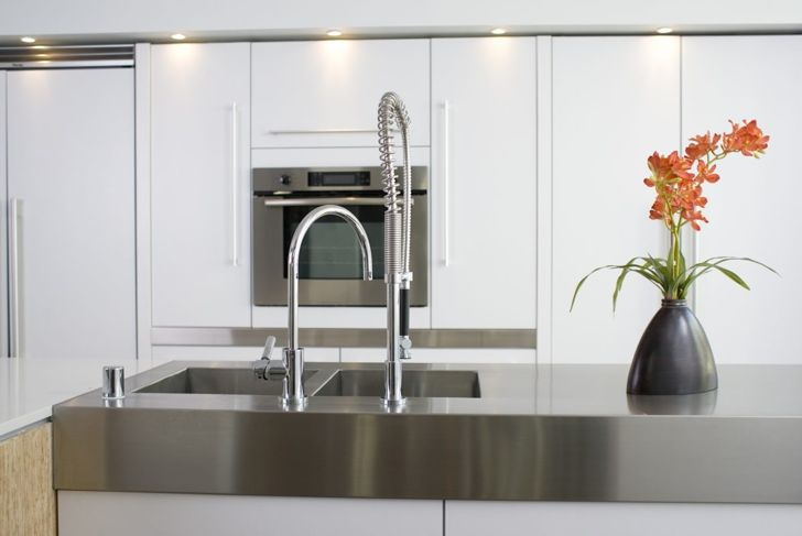 A stainless steel countertop makes this kitchen look sleek.