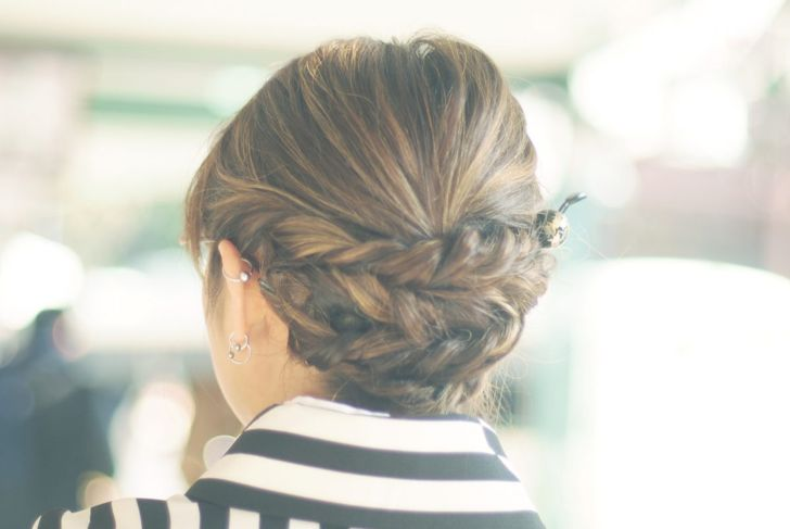 Three horizontal braids create a striking hairstyle for any occasion.
