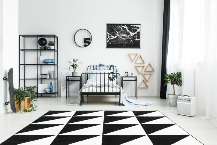 Bedroom with black and white furnishings