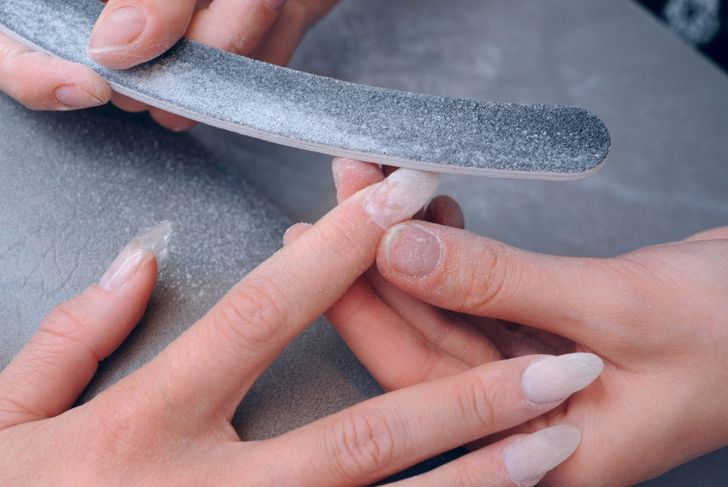 Buffing acrylic nails to remove