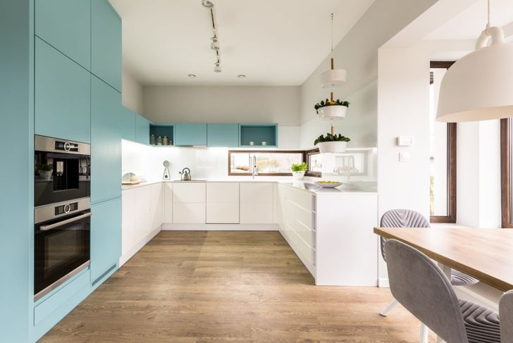 Turquoise cabinets keep this neutral kitchen from being too bland.