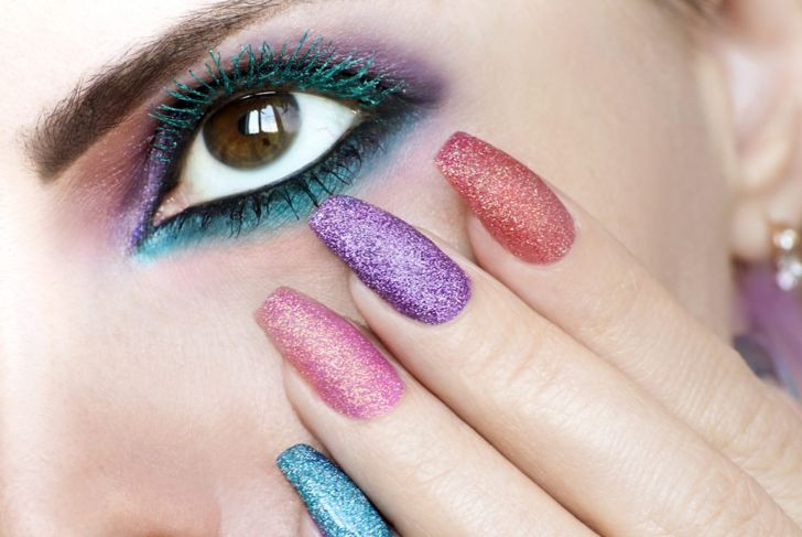 A square-shape manicure where each nail is a different shade of glitter