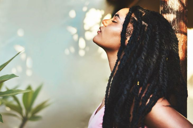 A woman with long and very thick box braids