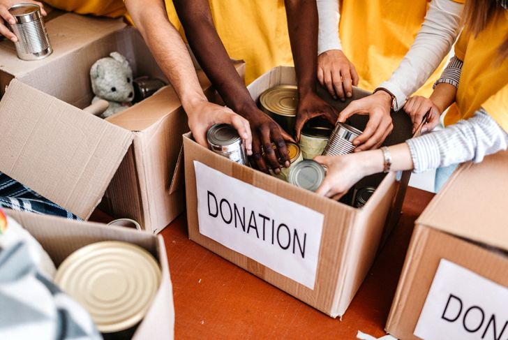 Small multi-ethnic group of people working on humanitarian aid project