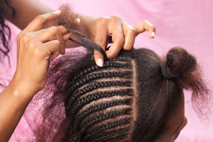 Updo African hairstyle with hair extension.