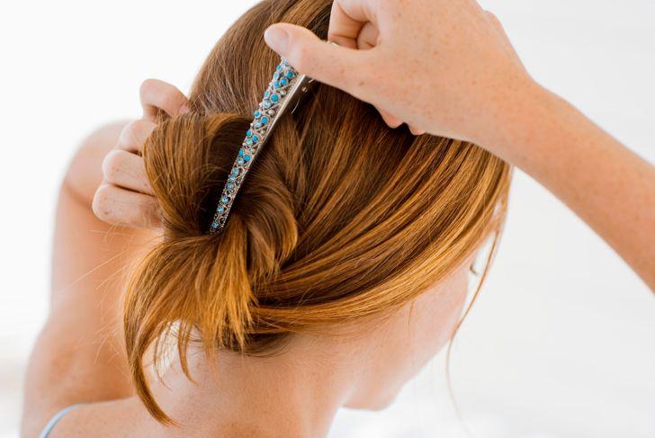 Woman clipping hair