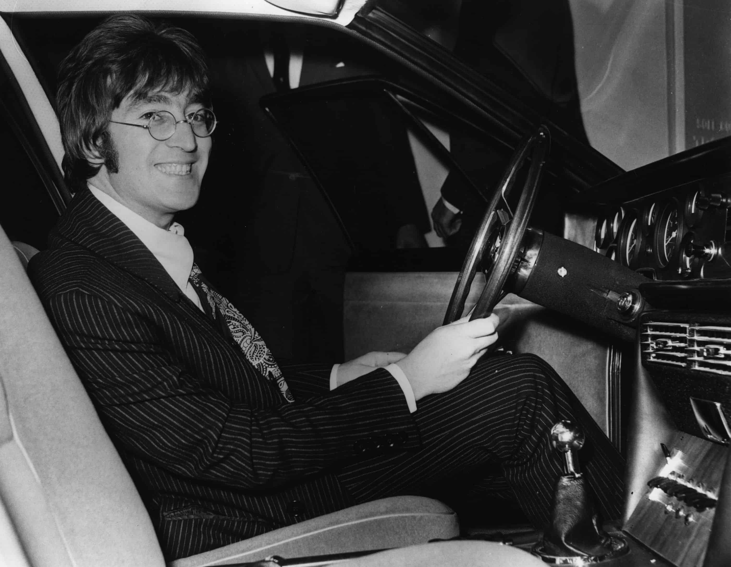17th October 1967: A happy John Lennon (1940 - 1980) at the wheel of the ISO Rivolta S4 car which he bought for £6,150 at the preview of the Motor Show.