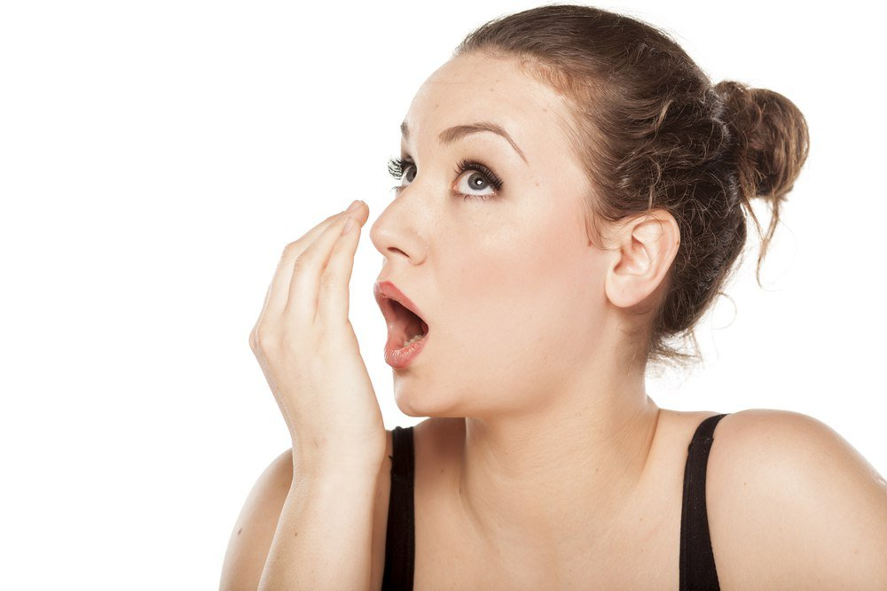 woman checking her bad breath