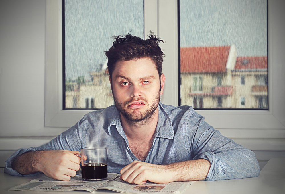 tired man with coffee