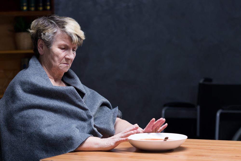 Depressed appetite- elderly woman refusing to eat meal