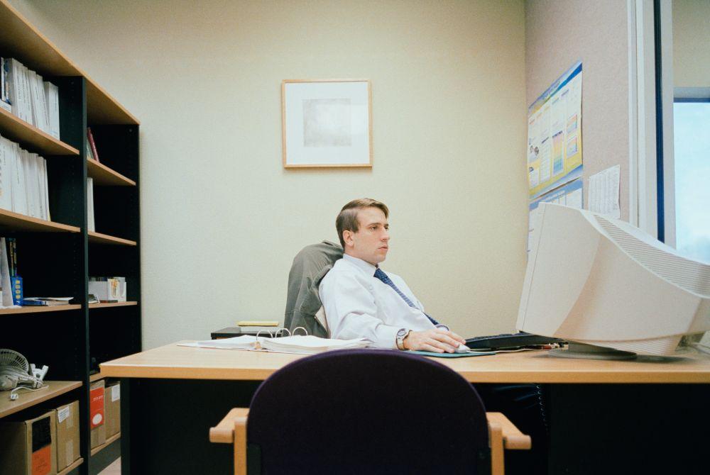 man slouching at desk shirt looks too big