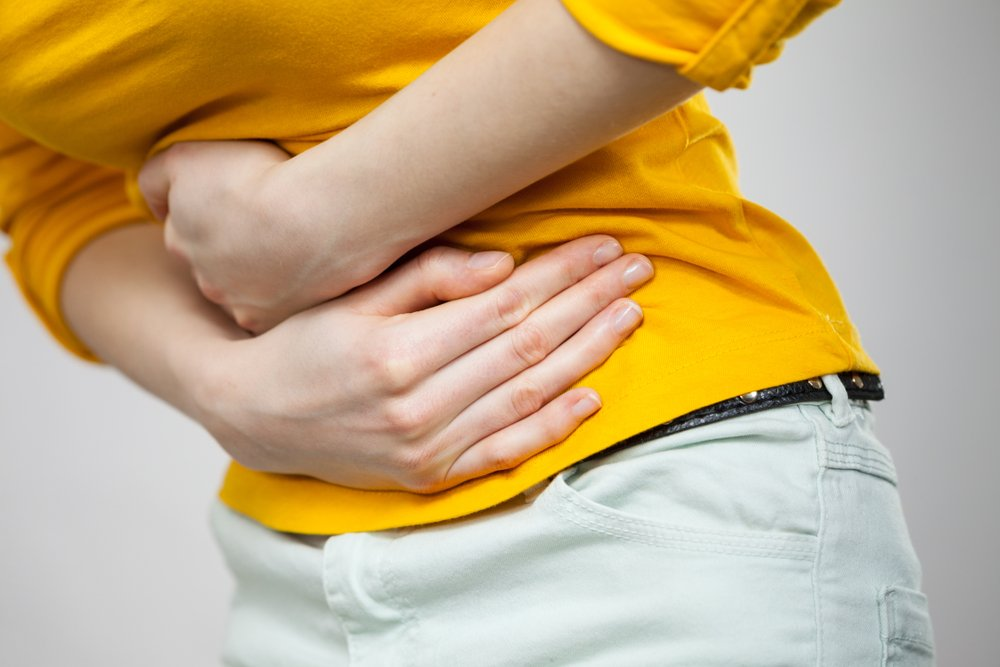 woman with stomach ache from turmeric