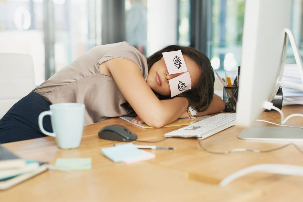 woman nap at desk catnap