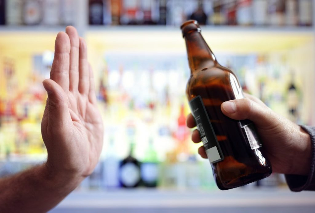 Hand waving refusing beer drink