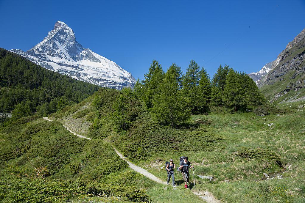 SWITZERLAND - JULY 07:  Hikers on walking trail below the Matterhorn mountain in the Swiss Alps near Zermatt, Switzerland (Photo by Tim Graham/Getty Images)