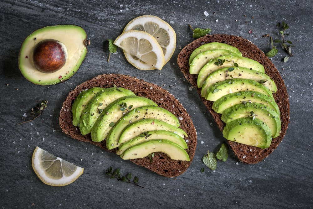 Avocado sandwich on dark rye bread made with fresh sliced avocados from above