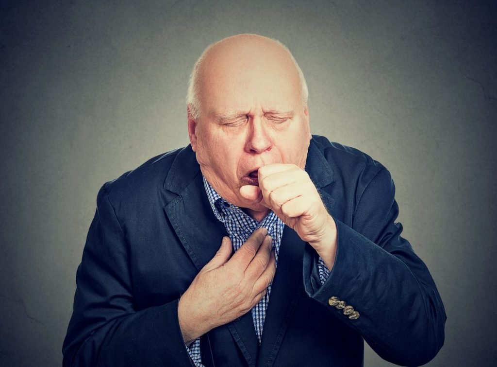 man coughing from sore throat