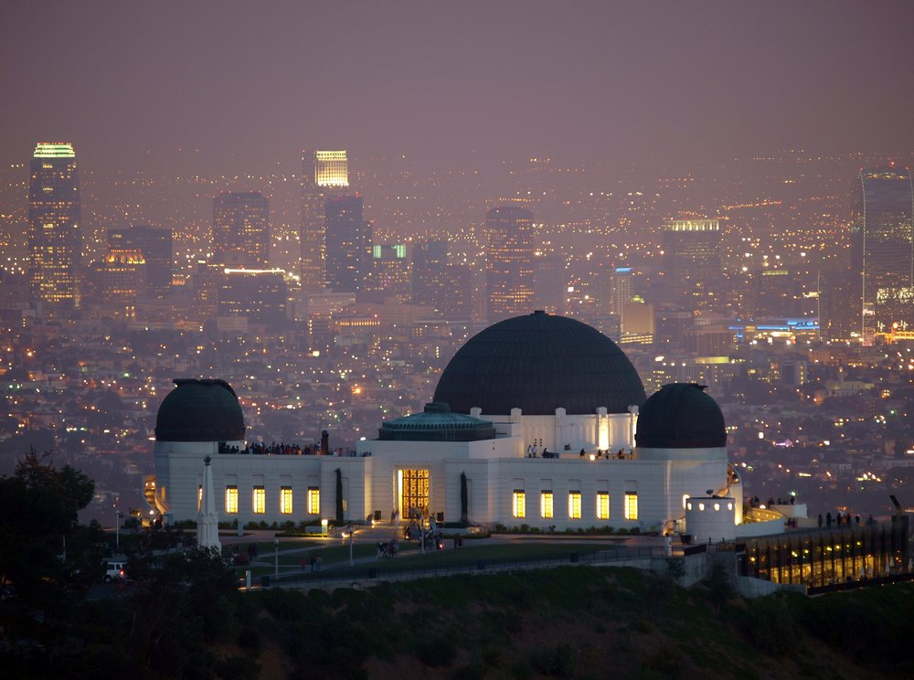 Visitors flock to Los Angeles's city owned Griffith Park Observatory on a slightly foggy night