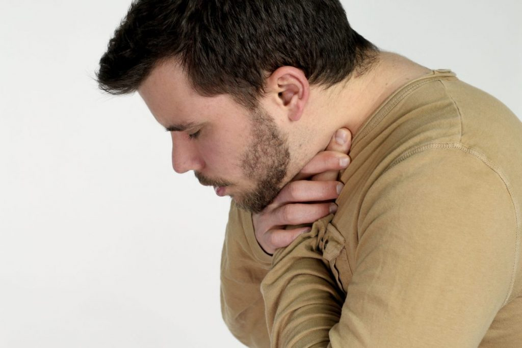Man performing universal choking sign