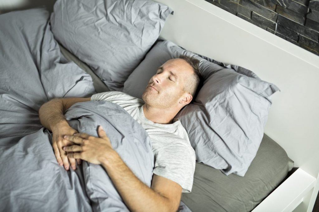 man sleeping supine